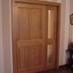Porte coulissante interieure, avec partie fixe et habillages en chêne